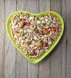 För fruktGranola för hjärta sädes- bunke för mysli arkivbilder