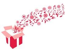 För gåvaask för röd färg anmärkning för musik och snöflingabakgrund arkivbilder