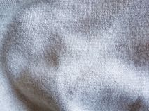 För grå bekvämt för tyg tröjavinter för textur varmt vävt naturligt Royaltyfria Foton
