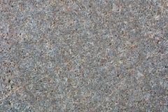 För grå färgsand för gul brunt bakgrund för textur för sten Arkivbilder