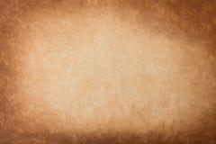 För grungebakgrund för tappning gammalt papper för textur Brunt bränd pappers- bakgrund Fotografering för Bildbyråer