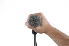 för handholding för bakgrund tät mikrofon upp white Arkivbild