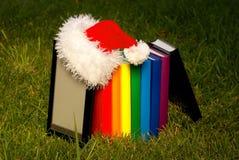 för hattavläsare s santa för bok elektroniskt slitage Fotografering för Bildbyråer