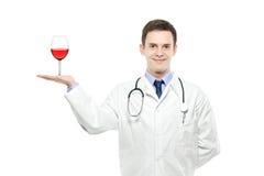 för holdingläkarundersökning för doktor glass wine royaltyfri fotografi