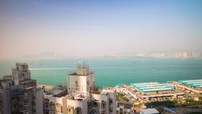 För Hong Kong för överkant för tak för sommardag porslin för schackningsperiod för tid för panorama 4k för hamn för byggnad fjärd lager videofilmer