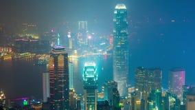 För Hong Kong för nattpeakscapenatt schackningsperiod för tid för panorama 4k för fjärd torn Kina arkivfilmer