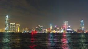 För Hong Kong kowloon för natt ljust porslin för schackningsperiod för tid för panorama 4k fjärd stock video