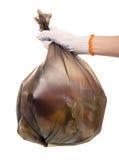 För hushållavfalls för kvinnlig hand som hållande packe isoleras på vit royaltyfria bilder