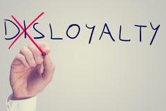 För illojalitet lojalitet kontra royaltyfri bild