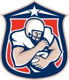 För innehavboll för amerikansk fotboll Retro sköld Royaltyfri Bild