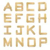 för isstick för alfabet kräm- trä Arkivfoton