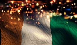 För `-Ivoire för skjul D för Bokeh för natt för ljus nationsflagga bakgrund abstrakt begrepp Arkivfoto