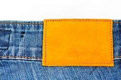 för jeanetikett för bakgrund blankt läder Arkivbild