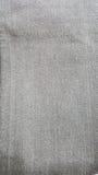 För jeansfack för tyg färgar texturerar gamla grå färger för svart, Arkivbilder