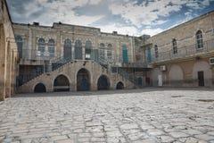 För Jerusalem för gammal stad byggnad unik skola, första station av korset Arkivbilder
