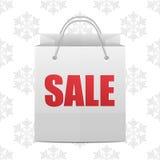 för julförsäljning för påse görad randig blå snowflake för shopping Arkivfoto