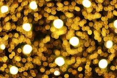 för julljus för abstrakt suddighet guld- bokeh för modell och baksida Arkivbilder