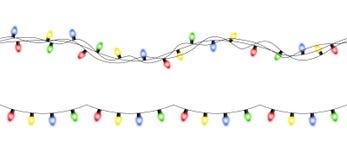 För julljus för vektor som färgrika sömlösa girlander isoleras på wh Arkivfoton