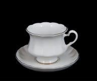 för koppsaucer för bakgrund svart tea Royaltyfria Bilder