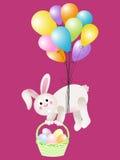 För korgpåsk för kanin som bärande ägg flyger med ballonger Arkivfoto