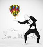 För kroppdräkt för man oavkortad ballong för innehav Royaltyfri Fotografi