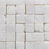 För kubtextur för vitt socker bakgrund Arkivfoto