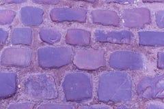 För kullerstenkörbana för textur forntida närbild Violet Color Royaltyfri Foto