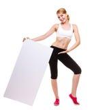För kvinnainnehav för kondition baner för annons för sportigt mellanrum tomt Royaltyfria Bilder