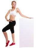 För kvinnainnehav för kondition baner för annons för sportigt mellanrum tomt Arkivbild