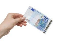 för kvinnlighand för euro 20 anmärkning Arkivfoto