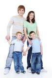 för längdstående för familj fullt lyckligt barn Arkivbild