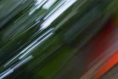 För lövverkabstrakt begrepp för rörelse suddig bakgrund för gräsplan för suddighet för natur Arkivbild