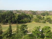 för landskapgräsplan för panorama lugna golf royaltyfria bilder