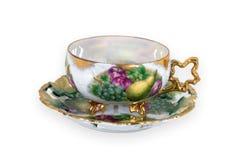 för livstid teacuptappning fortfarande arkivfoton