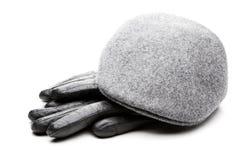 För locksvart för tweed grå bakgrund för vit för handskar för läder Royaltyfri Bild