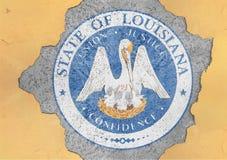 För Louisiana för USA-stat flagga skyddsremsa i stort konkret sprucket hål royaltyfria bilder