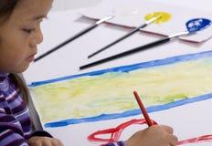 för målningsserie för barndom finshing touches arkivfoton