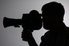 För manfilm för kontur skäggig kamera åt sidan Arkivfoto