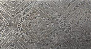 För moquemegane för Grunge som handgjorda geometriska texturer göras av metall arkivfoton
