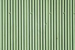 För murbrukvägg för grön färg textur med den vertikala modellen Arkivfoto
