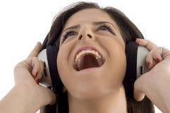 för musikkvinna för hörlurar med mikrofon lyssnande barn Arkivfoton