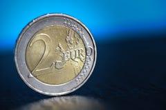 För myntfinans för euro två slut för begrepp för system upp Arkivfoto