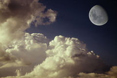för nattsky för blå moon stjärnor arkivfoton