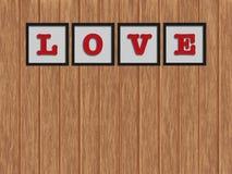 ` För ord`-FÖRÄLSKELSE i svart ram på väggen Fotografering för Bildbyråer