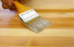 för paintbrushtextur för hand mänskligt trä Arkivbild