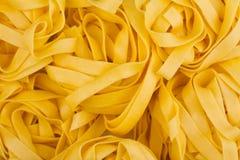 För pastatextur för tagliatelle italiensk bakgrund Arkivbild