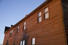För plankasiding för tappning Wood hus Arkivbild
