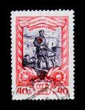 För portostämpeln för USSR Ryssland beväpnad ukrainare för shower tredskas, inbördeskriget 1918, circa 1958 Arkivfoton