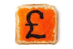 för pundsmörgås för kaviar monetär ett pund sterling arkivbild