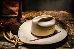 För RodeoCowboy för amerikan västra hatt på Lasso med kängor Arkivbild